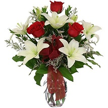 White lilies n roses in Vase: Thank You Flowers Canada