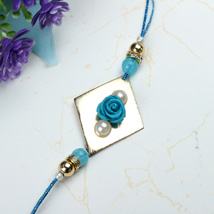 Blue Rose with Pearl Rakhi SWI: Send Rakhi to Switzerland