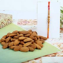 Almond nuts with Sandal Rakhi: Rakhi to Leeds