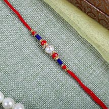 Elegant Red blue Rakhi: Send Rakhi to Leeds