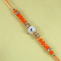Fancy Orange Diamond Rakhi: Send Rakhi to Leeds