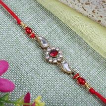 Sparkling Red Diamond bracelet: Send Rakhi to Leeds