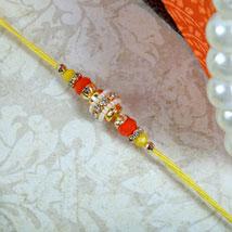 Sparkling yellow Thread: Rakhi to Leeds