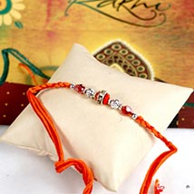 Glittering Maroon Rakhi Thread: Send Rakhi to Detroit