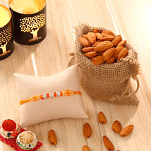 Orange Stone bead Rakhi with Almonds: Rakhi With Dryfruits USA